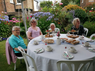 Photos of The Richmond Charities' Afternoon tea with bubbles in the award-winning garden at Michel's Almshouses